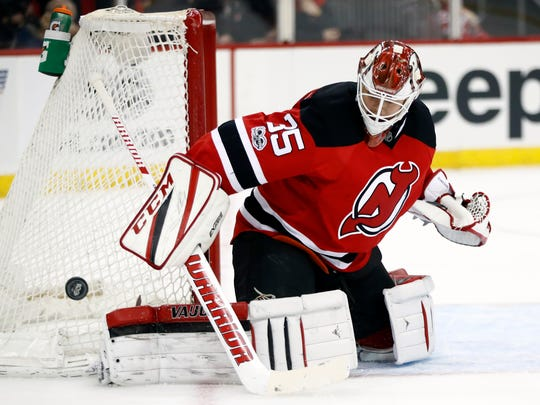 Devils goalie Cory Schneider deflects a shot for one of his 21 saves against the Senators on Tuesday night. Ottawa won, 2-1, in Newark.