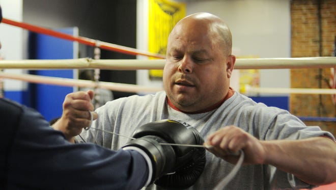Ray Rivera, shown tying a boxer's gloves at the Newburgh Boxing Club in 2010, pleaded guilty on drug charges on Monday.