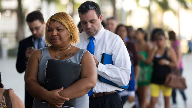 Job seekers stand in line at a job fair in Miami on Jan. 14.