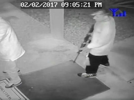 Surveillance video still shows a man stepping forward