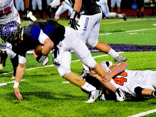 North Union's Garrett Miller (40) keeps CHCA's Johnny