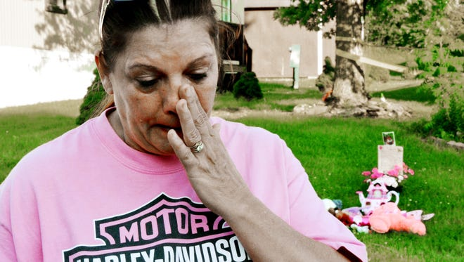 Erma Lapinski of Jackson Twp. remembers three-year-old Isabel Rose Godfrey, 3, and her mom Regina Lester as Lapinski talks outside of the Chesapeake Estates home in Jackson Twp., where her mom allegedly killed her daughter on Wednesday. There is a vigil planned for Friday evening outside of the home. Randy Flaum photo
