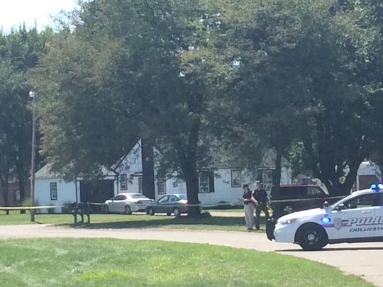 Police and sheriff's deputies investigate a shooting incident Monday on Reservation Circle.