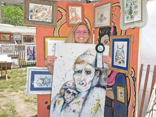 Emily Donovan of Howell shows off her first-place ribbon awarded at the 2016 Art in the Park event in Long Branch. Dozens of artists in a variety of media will be taking part in the 19th annual outdoor art and artisanal crafts fair, which returns to West End on Sunday, May 28.