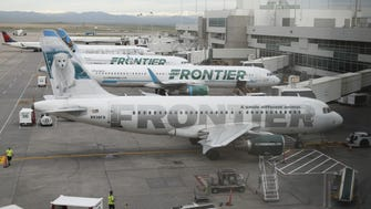 This file photo from May 15, 2017, shows Frontier Airlines jets at Denver International Airport.