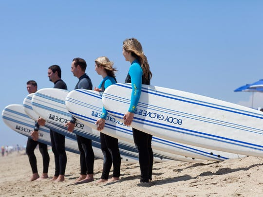 California's surf culture draws millions of visitors to Huntington Beach year-round for an endless summer of ocean swells.