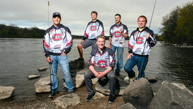 Members of the St. Cloud State University Husky Bass Fishing Team are shown Thursday, April 21, 2016, along the Mississippi River near campus. Standing, left to right are Alex Almich, Tyler Gromberg, Dan Carlson and Joachim Speldrich; Seth Cupersmith sits in front.