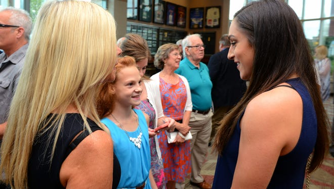 Olympic gold medalist and DeWitt native Jordyn Wieber, right, talks with Tasha Senterfit, 11, before the start of the Lansing Sports Hall of Fame banquet Thursday, July 28, 2016 at the Lansing Center. Senterfit competes in gymnastics at the Twistars Gymnastics Club.