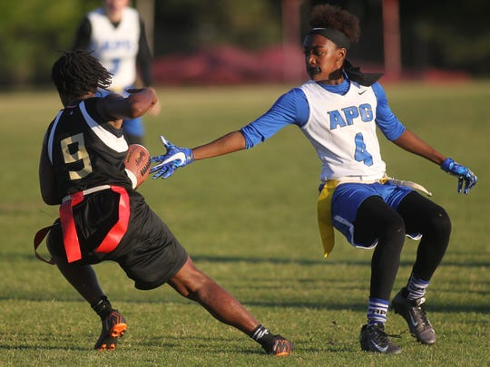 Florida High quarterback Janae Scott makes a cut past the grasp of Godby's Armarni Williams.