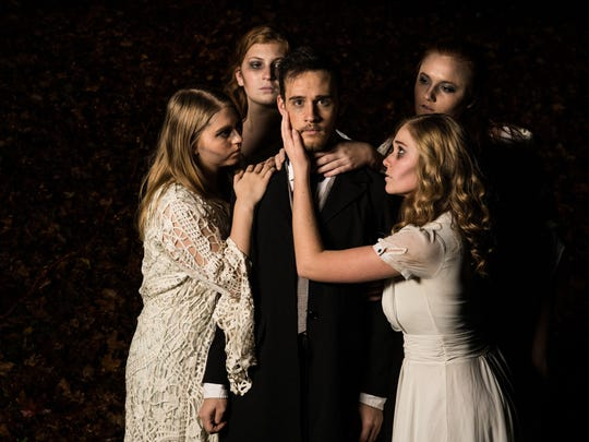 "William Bunch stars as poet Edgar Allan Poe in InBocca Performance's production of ""A Dream Within a Dream,"" being performed Jan. 20-23 at the Woodward Theater, 1404 Main St., Over-the-Rhine. Surrounding Bunch are (clockwise, from L) Sydney Cooper, Lillian Reynolds, Kelly Lumbert and Kenzie Gabbard."