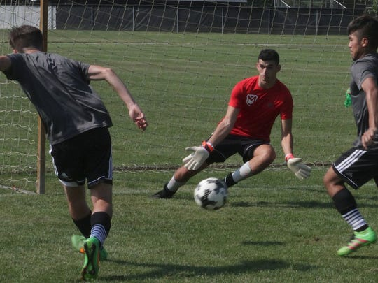 Justin Meredith, in red, played soccer and ran track during his two years at Saint Joseph's College. When the school in Rensselaer closed after the spring 2017 semester, Meredith landed at Manchester University, a liberal arts school in North Manchester, Indiana. He plays soccer and plans to join the track team there, too.
