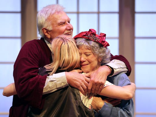 """Gary Zurbuchen, playing Gardner Church, hugs Nancy Ernst, playing Fanny Church, and Mary Magiera, playing their daughter Margaret """"Mags"""" Church, during a rehearsal for """"Painting Churches"""" Tuesday at UW-Fox Valley in Menasha. The production is a collaboration between Attic Theatre and the Fox Valley Memory Project."""