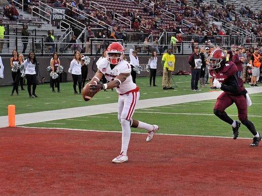 USD receiver Alonge Brooks hauls in a 57-yard pass