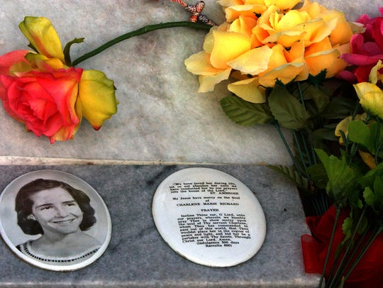 Photo and prayer on the grave site of Charlene Richard