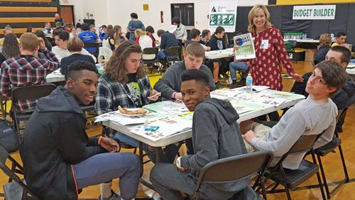 Eight employees from First Capital Federal Credit Union volunteered as financial advisors for Junior Achievement's Real Life, a financial literacy program, on Feb. 21 at Red Lion Area High School. Pictured is Sue DeStephano, First Capital FCU president/CEO, with Red Lion seniors participating in the program.