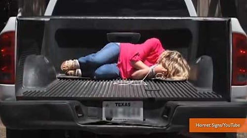 Texas sign company destroys tailgate decal of bound woman