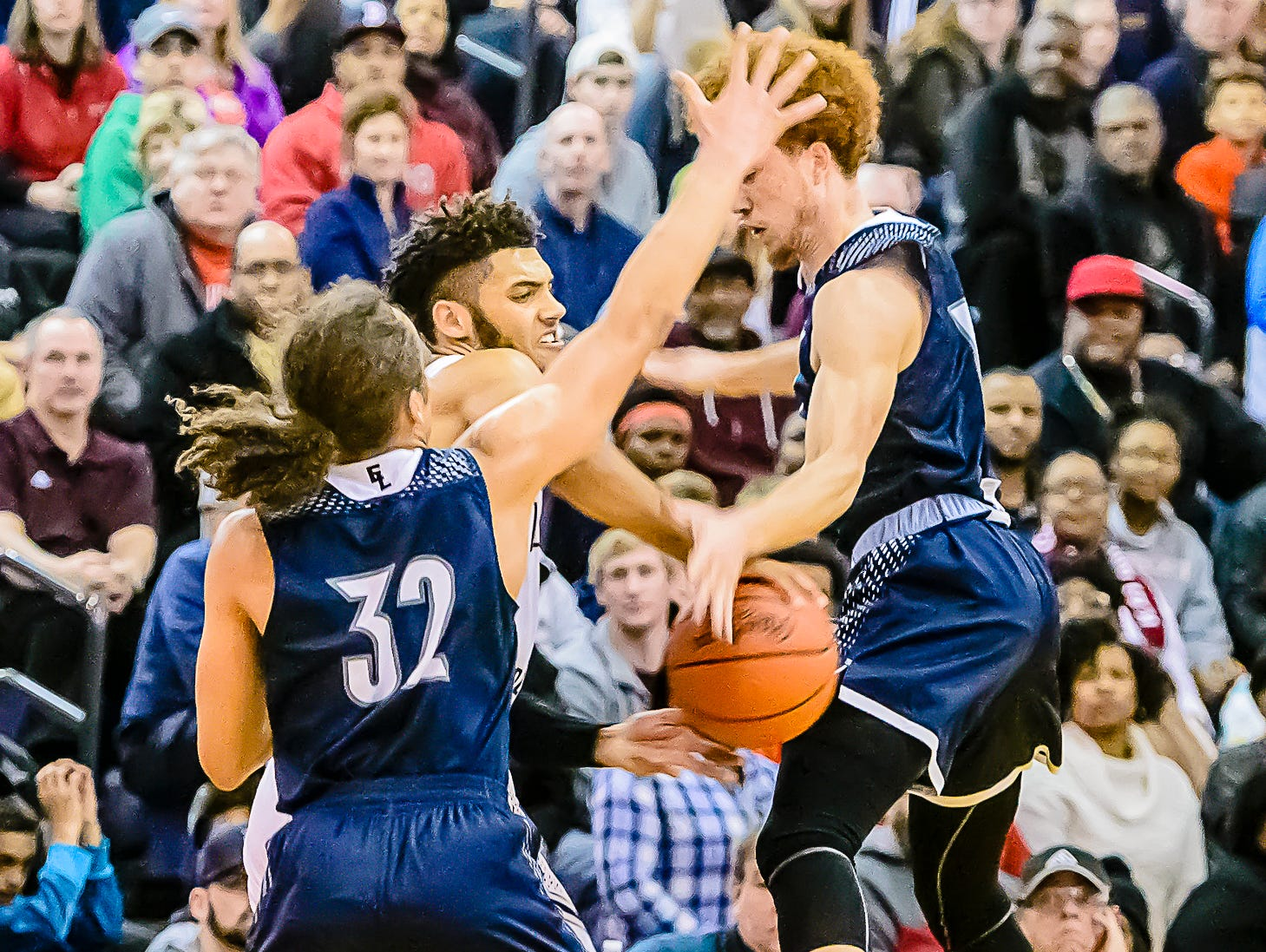 Deandre Robinson ,right, of East Lansing gets a hand on the ball to force a turnover as Isaiah Livers ,center, of Kalamazoo Central attempts to pass out of a double team late in the 2nd quarter of their Class A Regional Final game Wednesday March 15, 2017 at Gull Lake High School in Richland.