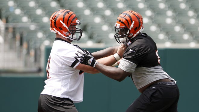 Can rookie center Russell Bodine, left, play like a veteran traffic cop?