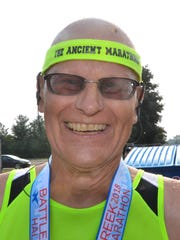 Irvin Kontowski, 70, is all smiles after completing the Battle Creek Half Marathon on Saturday, June 30, 2018.