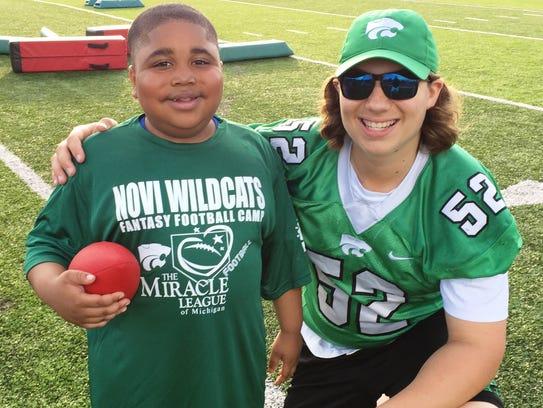Novi junior middle linebacker Ryland Bennett (right)
