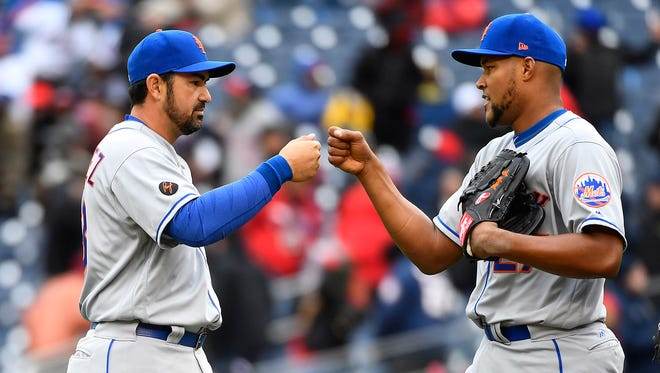 Apr 7, 2018; Washington, DC, USA; New York Mets first baseman Adrian Gonzalez (23) congratulates relief pitcher Jeurys Familia (27) after earning a save against the Washington Nationals at Nationals Park.