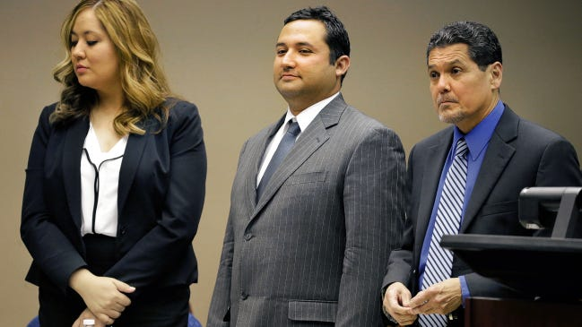"""Former Socorro city Rep. Jesus """"Jesse"""" Gandara Jr., center, stands with his attorneys just after closing arguments were held in his bribery trial last year."""
