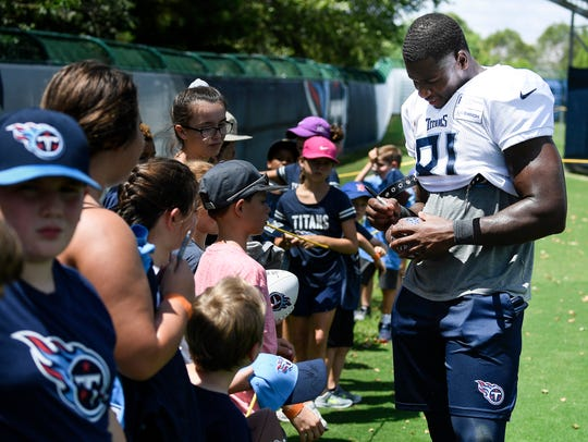 Titans tight end Jonnu Smith signs autographs for fans after a training camp practice at Saint Thomas Sports Park in 2018.