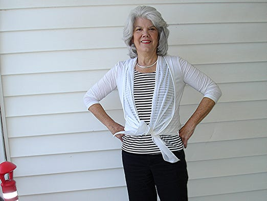 Elizabeth Holsberry Retired teacher.   Her style: I'm more casual now that I'm not working ... but I'm still traditional and not outlandishly trendy. I like to wear somewhat fitted pants but not skinny ones. I have capris on now, and I wear all colors, white, browns, black. My tops are either T-shirts or tank tops with crew or boat neck. I'm not really big on jewelry, though I have a few special pieces. I wear flats and use a medium to large shoulder handbag. Favorite shops: Chico's and Stein Mart. For this story and more stories and photos, see the August issue of Pensacola Bella Magazine, and go to www.BellaMagazine.com.