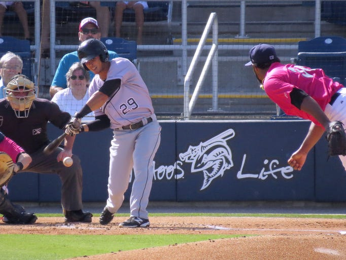 Terrence Dayleg of the Jacksonville Suns, No. 29, connects on a pitch by Pensacola Blue Wahoos pitcher No 36, Daniel Corcino to blast a three run homer for the Suns in early game action Sunday afternoon at the Blue Wahoos stadium.