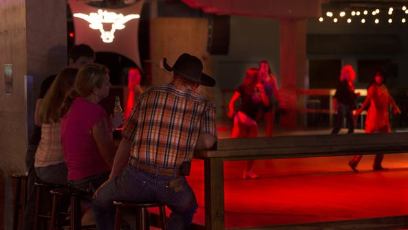 Line dancers take advantage of the 4,000-square-foot