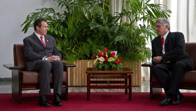 New York Gov. Andrew Cuomo, left, meets April 21, 2015, with Cuba's first vice president, Miguel Díaz-Canel, at Revolution Palace in Havana.