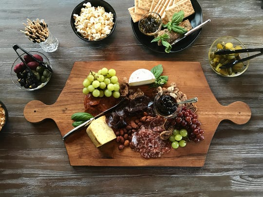 Charcuterie – distinctive sliced meats – with fruit,