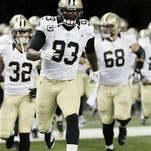 In this Sunday, Oct. 19, 2014 file photo, New Orleans Saints outside linebacker Junior Galette (93) leads the team on to the field for an NFL football game against the Detroit Lions in Detroit. The New Orleans Saints have cut Junior Galette, who has been among their top pass-rushers the past two seasons and last year signed a four-year, $41.5 million contract extension.