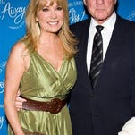FILE - In this March 25, 2010 file photo, Kathie Lee Gifford and Frank Gifford arrive at the opening night performance of the Broadway musical 'Come Fly Away' in New York. In a statement released by NBC News on Sunday, Aug. 9, 2015, his family said Gifford died suddenly at his Connecticut home of natural causes that morning.