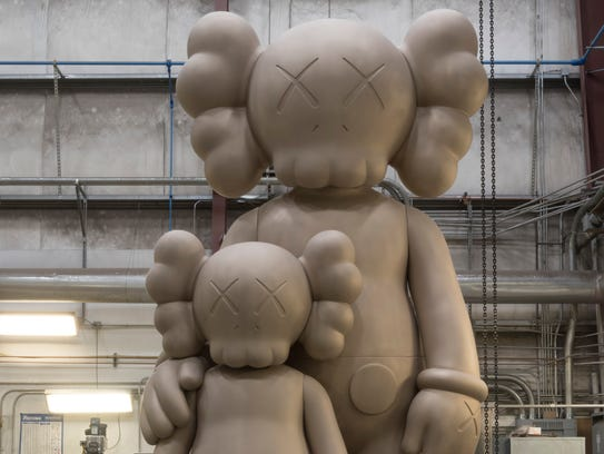 "The statue ""Waiting"" by noted contemporary artist Kaws"