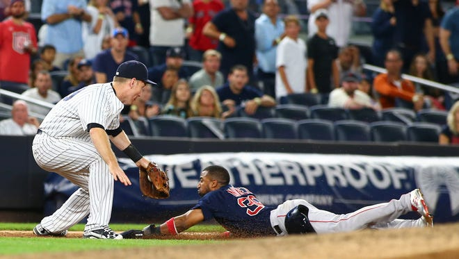Aug 11, 2017; Bronx, NY, USA; Boston Red Sox second baseman Eduardo Nunez (36) is tagged out at third base by New York Yankees third baseman Todd Frazier (29) after attempting to advance on a sacrifice fly during the ninth inning at Yankee Stadium.