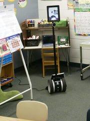 Joseph Lazarewicz navigates a remote robot into a charging
