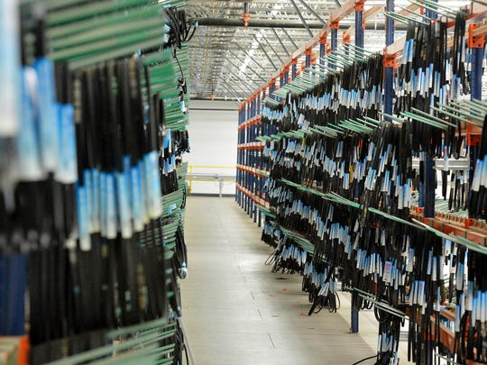 Belts are stored on racks within the Fisher Auto Parts' warehouse on Morris Mill Rd in Staunton on Thursday, April 3, 2014.