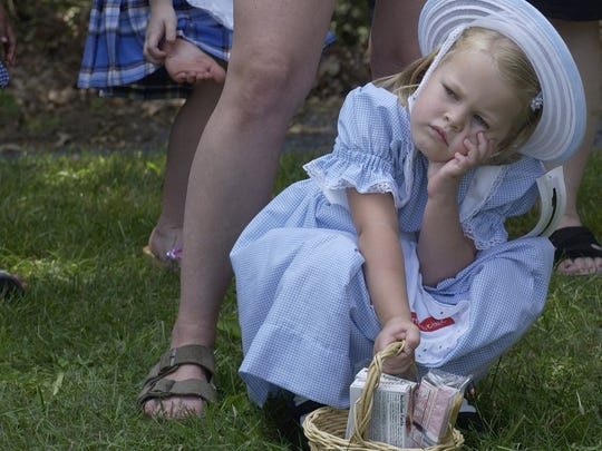 Gracie Shook, 4, a Little Debbie Look-Alike contestant waits for the contest to begin during the Sweet Dreams festival in Stuarts Draft on Saturday, July 23, 2005.