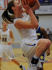 Maci Heimlich drives to the basket for North White
