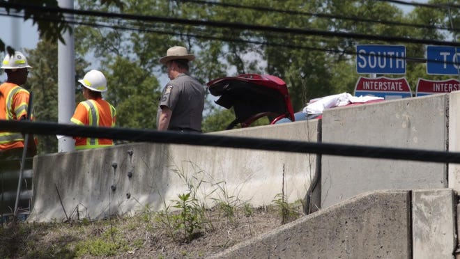 State Police and investigators at the scene of a fatal car accident that killed a Brooklyn teenager at the southbound ramp to Rye Playland on Interstate 95.