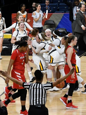 Marist players react as Quinnipiac players celebrate a win in the Metro Atlantic Athletic Conference final Monday in Albany.