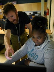 Kelaylah McAlpin gets help from teacher Robert Winter  during coding class at Carter Middle School Thursday, Oct. 26, 2017. Knox County Schools is pushing to get more students coding and has developed a dedicated computer science curriculum.