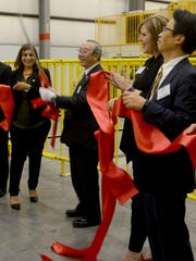 President/CEO of Pacific Industries Shinya Ogawa celebrates