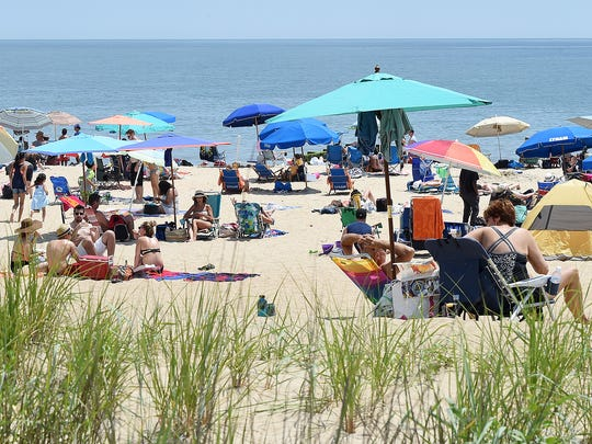 Beach-goers fill Rehoboth Beach on Thursday. A fireworks display is planned Sunday.