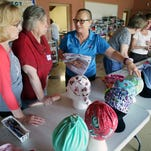 Volunteers top 10,000 turbans for cancer patients