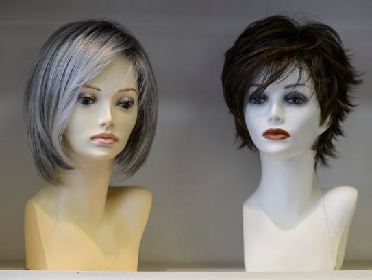 Wigs are displayed at The Cottage Wig Shoppe located