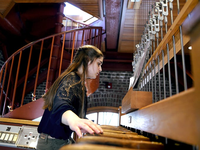 Chimemaster Emma Jacob plays a chimes concert in McGraw