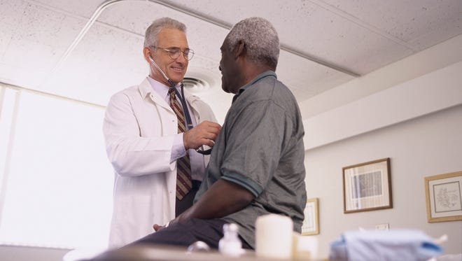 Male doctor examining a male patient