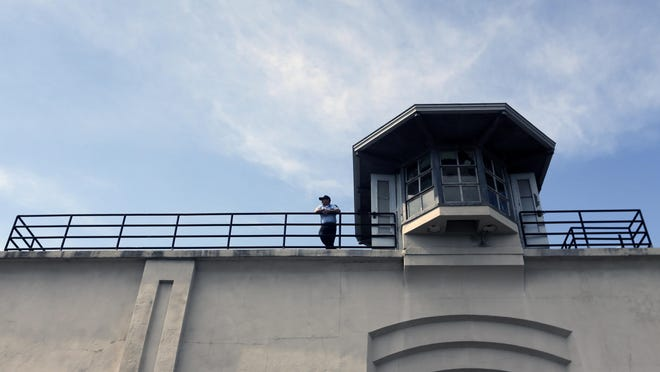 A guard stands on the wall of Clinton Correctional Facility on Saturday, June 13, 2015, in Dannemora, N.Y. Authorities are in the eighth day of searching for David Sweat and Richard Matt, two killers who used power tools to cut their way out of Clinton Correctional Facility in northern New York. (AP Photo/Mike Groll)